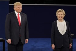 Republican presidential nominee Donald Trump  stands next to Democratic presidential nominee Hillary Clinton during the second presidential debate at Washington University in St. Louis, Sunday.