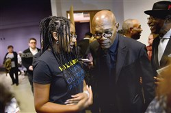 Mina Bray of the North Side asks actor Samuel L. Jackson a question Sunday as he greets attendees at the August Wilson Center for African American Culture, Downtown, after a memorial for actor Bill Nunn III, who died in September in his family's home in the Hill District. Ms. Bray was a student in the Bill Nunn Theater Outreach Project.