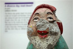 "The damaged garden gnome is labeled ""Divorce Day Mad Dwarf"" at the Museum of Broken Relationships."