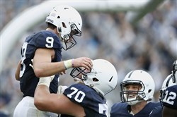 Trace McSorley (9) and lineman Brendan Mahon (70) celebrate Penn State's win against Maryland in October, but injuries along the offensive line will make things tougher for the Nittany Lions down the stretch.