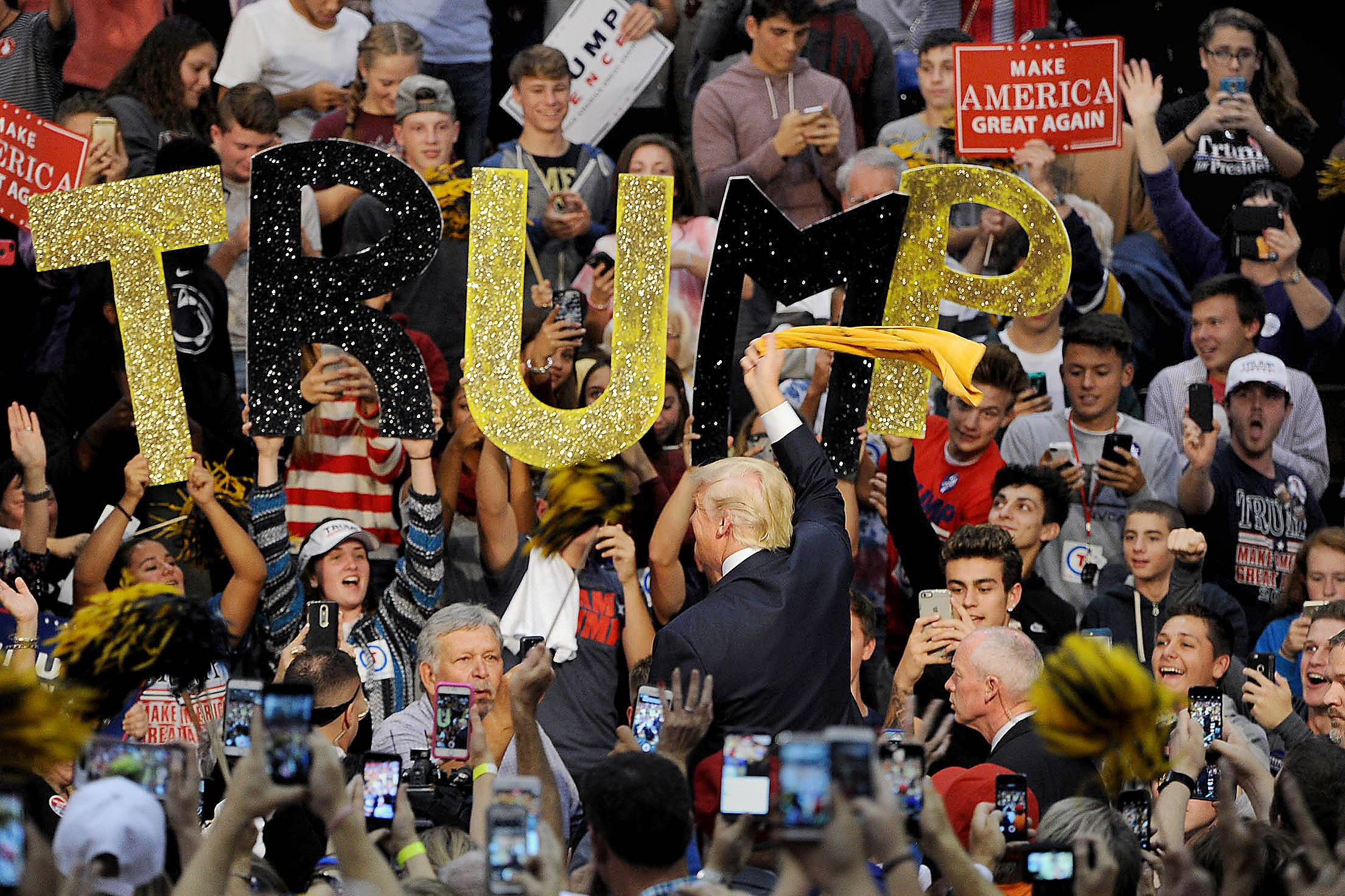 20161010MWHtrumpLocal09 Donald Trump waves the Terrible Towel as he enters a campaign event at Ambridge High School on Monday.