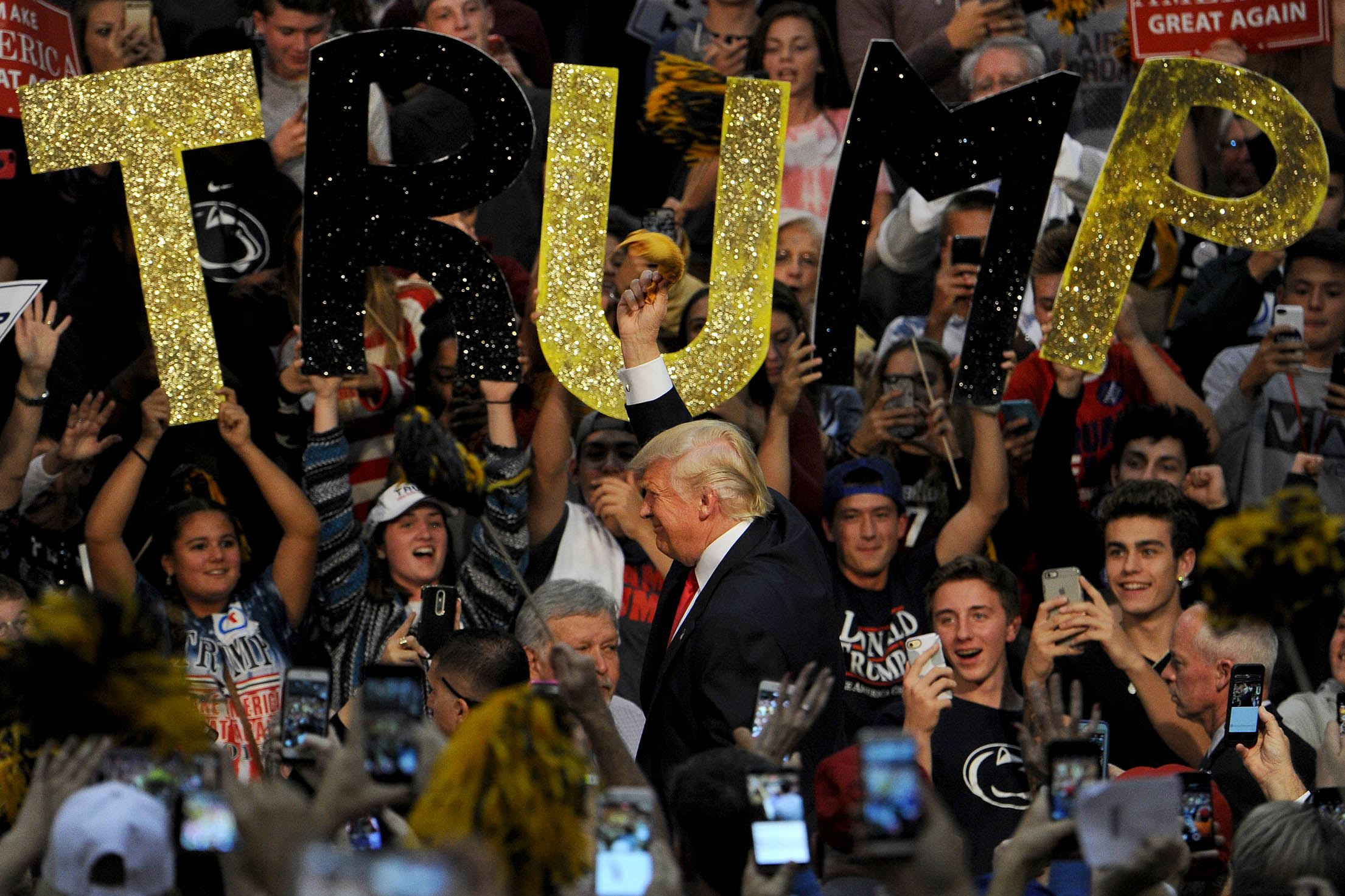 20161010MWHtrumpLocal10-1 Donald Trump waves the Terrible Towel upon entering a campaign event at Ambridge High School on Monday.