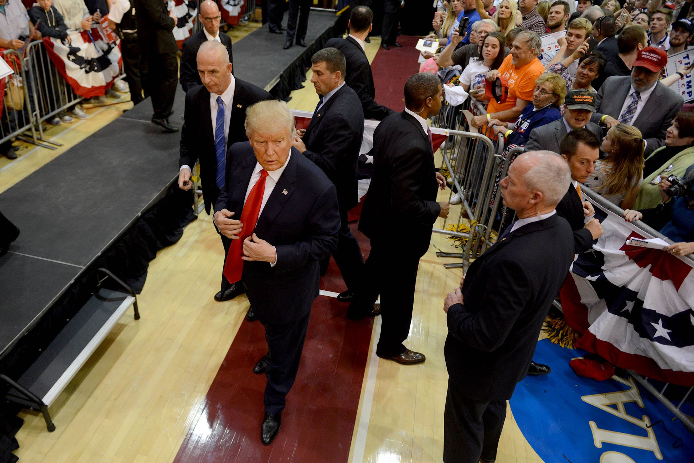 20161010MWHtrumpLocal08 Donald Trump works the rope line after speaking at Ambridge High School on Monday.