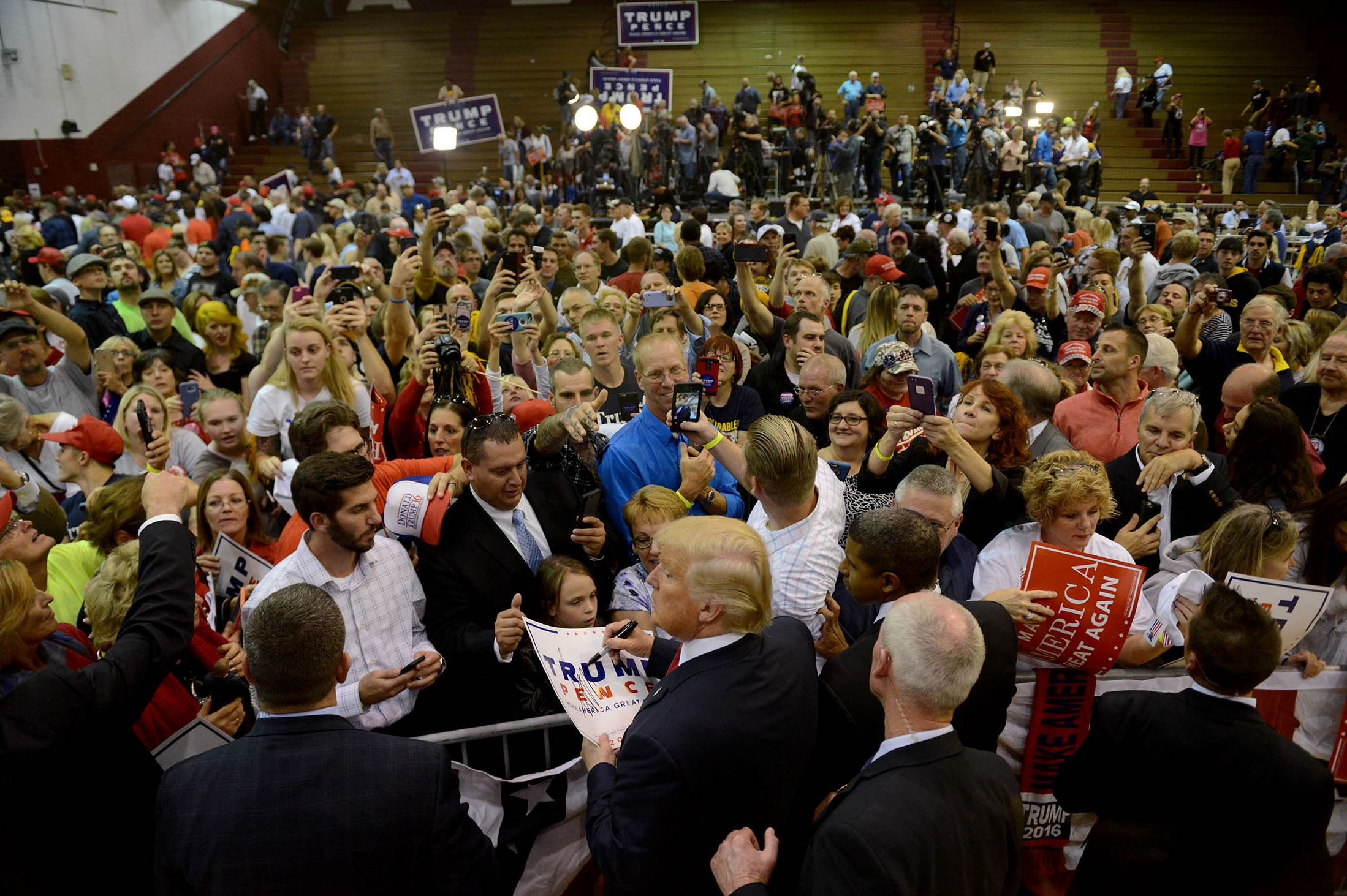 20161010MWHtrumpLocal13-4 Republican presidential candidate Donald Trump works the rope line after speaking at Ambridge High School on Monday.