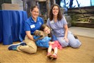 "Christa Gaus, Violet Spataro and Pilar Fish spend quality time with infant two-toed sloth Valentino at the National Aviary in Pittsburgh. The segment will air Oct. 12 at 4 p.m. on ""The Ellen DeGeneres Show."" Ms. Gaus is assistant manager of behavior management and education; Dr. Fish is director of veterinary medicine."