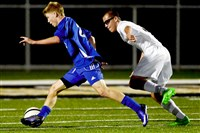 South Park's Mitchell Roell dribbles on a breakaway Oct. 11 while being pursued by Keytone Oaks' Austin Oleksak.