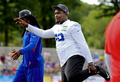 New Steeler Karlos Williams takes part in conditioning drills at Buffalo Bills training camp in July. Williams was cut by the Bills and on Wednesday agreed to join the Steelers practice squad. His brother, Vince, also is a Steeler.