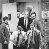 "Charles J. ""Chucky"" Porter, center in black jacket, and other defendants are led from the back door of the courthouse in 1990 after being convicted on racketeering charges."