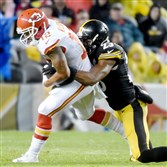 Mike Mitchell takes down the Chiefs' Albert Wilson in the third quarter Sunday at Heinz Field.