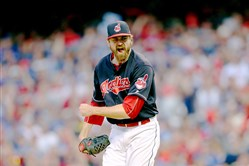 Indians reliever Andrew Miller lets out a yell after striking out Toronto's Josh Donaldson in the eighth inning Saturday of ALCS Game 2 in Cleveland. Miller has 10 strikeouts over his first two appearances in the series.