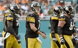 Steelers quarterback Ben Roethlisberger walks off the field after he couldn't convert a third down against the Dolphins in the fourth quarter Sunday at Hard Rock Stadium.
