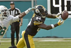 The Steelers' Antonio Brown pulls in a pass against the Dolphins' Tony Lippett in the third quarter Sunday at Hard Rock Stadium in Miami Gardens, Fla. Brown, the league's leading receiver, had only four catches in the Steelers' loss.