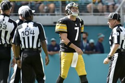 Steelers quarterback Ben Roethlisberger walks off the field after throwing an interception Sunday against the Dolphins.