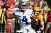 Cowboys QB Dak Prescott delivers a pass Sunday against the Green Bay Packers at Lambeau Field.