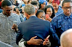 President Barack Obama hugs a student Monday after delivering remarks on education at Benjamin Banneker Academic High School in Washington, D.C. America's high school graduation rate reached a record 83.2 percent.