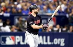 Cleveland Indians first baseman Mike Napoli hits a solo home run in the fourth inning against the Toronto Blue Jays Monday at Rogers Centre in Toronto. The Indians won and took at 3-0 lead in the best-of-seven American League Championship Series.