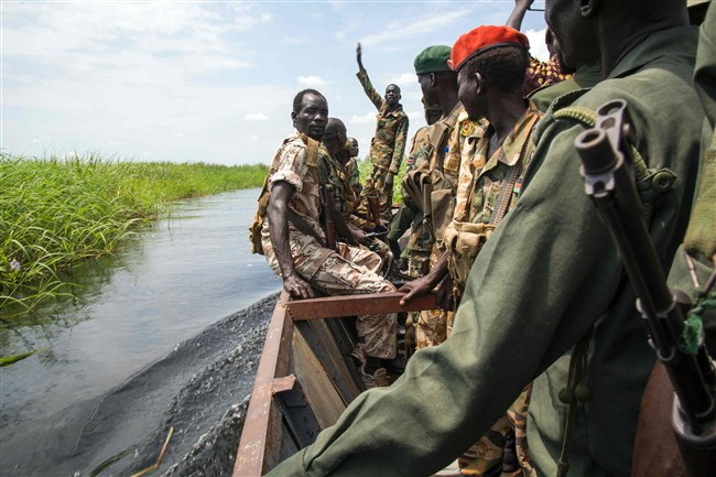 Soldiers of the Sudan People Liberation Army cross the Nile River in a boat near Malakal, northern South Sudan, on Sunday.