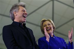 Democratic presidential candidate Hillary Clinton stands on stage with musician Jon Bon Jovi during a campaign stop at Rutgers University in Newark, N.J., in June.