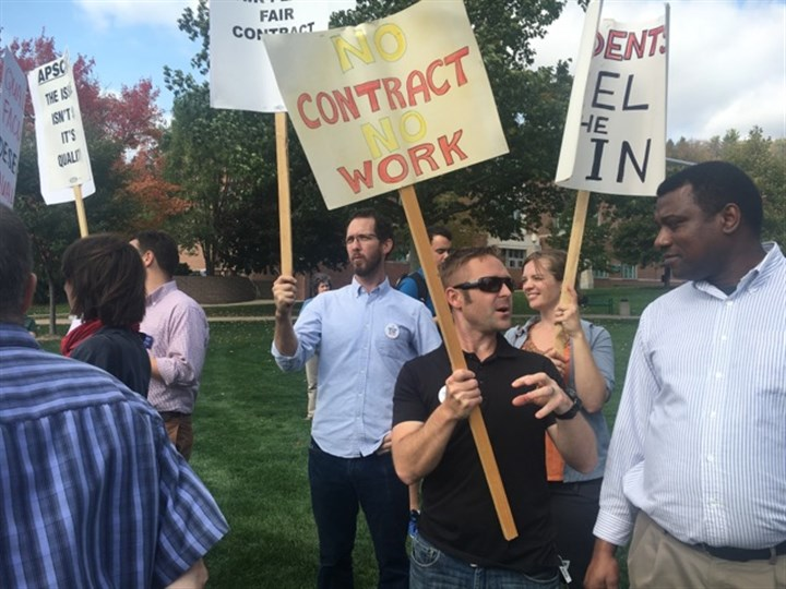 IMG_0942.jpg Assistant professor Shawn Davis joins nearly 200 faculty and students who rallied on the Slippery Rock University campus Tuesday afternoon.