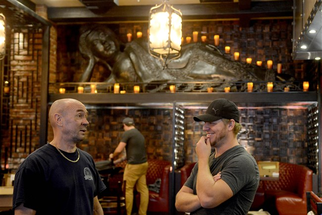 Part owner Mike DeSimone, right, speaks with construction supervisor Miles Miller while preparing Social House Seven, the Izakaya-style Asian restaurant, for its opening next week Downtown.