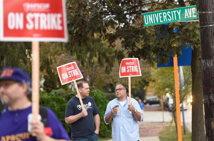 faculty strike 10192016 West Chester University professors Chris Stangl, left, and John Elmore carry picket signs as they and other faculty in the Pennsylvania State System of Higher Education went on strike as of 5 a.m. today.