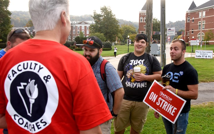 20161019dsStateUStrikeLocal05.jpg Facing left to right, Seth Denne, of Elizabeth, and Jay Niehenke, of Belle Vernon, seniors at Cal U, and sophomore Alex Pascqualle of Export talk to teachers on the picket line on campus this morning.