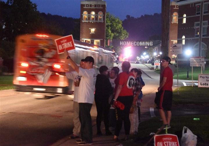 20161019dsStateUStrikeLocal01.jpg Faculty at California University of Pennsylvania stand along Third Street near the entrance of the university early this morning in Washington County.