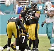 Teammates help Steelers quarterback Ben Roethlisberger to his feet after taking a hit from Dolphins' Ndamukong Suh late in the fourth quarter last week. With Roethlisberger and other key players out this week, things could get ugly against the Patriots.