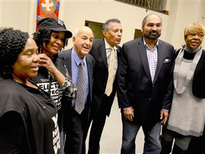 Tim Stevens, center, chairman of the Black Political Empowerment Project, stands with Cyril Wecht and Franco Harris on Thursday at a forum on election fairness at the East Liberty Presbyterian Church.