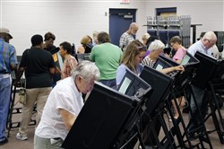 Voters fill the stations as hundreds came out on the first day of early voting at the Hope Mills Recreation Center in Hope Mills, N.C. on Thursday.