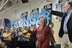 Hillary Clinton and Time Kaine enter Allderdice High School for a rally in Squirrel Hill on Saturday.