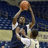Pitt's Jamel Artis gets a shot up during the team's Blue-Gold scrimmage Saturday at Petersen Events Center.