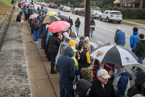 Rain comes down on Hillary Clinton supporters waiting in line to hear the presidential nominee speak at Allderdice High School in Squirrel Hill on Saturday.