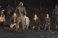 "From left, kneeling, Danai Gurira as Michonne; Michael Cudlitz as Abraham; Lauren Cohan as Maggie; Andrew Lincoln as Rick and Sonequa Martin-Green as Sasha face the bat-wielding Jeffrey Dean Morgan as Negan in ""The Walking Dead."""