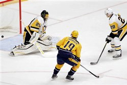 Nashville Predators center Calle Jarnkrok scores against Pittsburgh Penguins goalie Marc-Andre Fleury and defenseman Ian Cole during the second period of Saturday's game in Nashville.