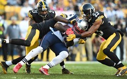 Mike Mitchell and Robert Golden wrap up LeGarrette Blount at Heinz Field.
