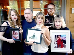 The family of social media star Katie May, who recently passed away: from left, her sister Megan Mitchell, her father Joe May, her sister Jenny McKerrow, her brother Stephen May, and her mother Janet May pose in the May home in Pleasant Hills earlier this month.