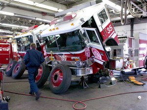 Fire trucks out of service for inspection and repairs at the city's garage in the Strip District.