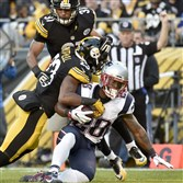 The Patriots' James White runs into the end zone for a touchdown against Steelers safety Mike Mitchell in the first quarter Sunday at Heinz Field.