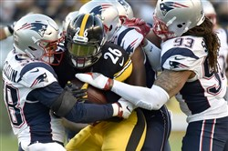 Steelers running back Le'Veon Bell is stopped by a small army of Patriots defenders during an Oct. 23, 2016, game at at Heinz Field.