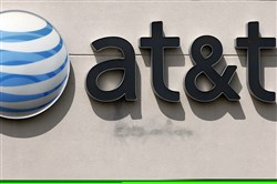 This 2014 file photo shows an AT&T logo on a store in Dedham, Mass.