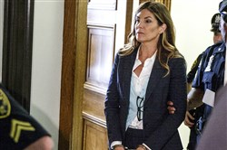Former state Attorney General Kathleen Kane leaves court in handcuffs after her sentencing Monday.