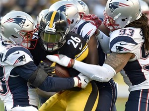 Le'Veon Bell looks for running room against the Patriots Oct. 23.