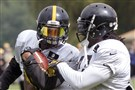 LeGarrette Blount, right, tries to strip the ball from fellow Steelers running back Le'Veon Bell during a drill in August 2014 at training camp in Latrobe, Pa.