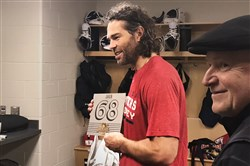 Panthers winger Jaromir Jagr holds up a piece of the Civic Arena roof that was presented to him from the Penguins on Tuesday.