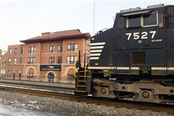 A locomotive sits in the foreground of  tthe Wabtec Complex in Wilmerding.