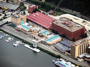 An aerial photograph of Station Square in 2012. Trammell Crow Co. hopes to start construction of an apartment complex in the area to the left of the Smithfield Street Bridge.