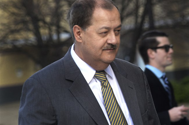 In an April 6, 2016, photo, former Massey CEO Don Blankenship is escorted by Homeland Security officers from the Robert C. Byrd U.S. Courthouse in Charleston, W. Va. Attorneys for Blankenship and the federal government head to court this week in the ex-coal operator's appeal of his conviction in connection with the deadliest U.S. mine disaster in four decades. Oral arguments are scheduled for Wednesday, Oct. 26, before a three-judge panel at the 4th U.S. Circuit Court of Appeals in Richmond, Va.