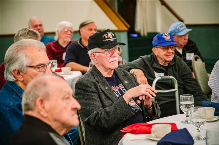20161025arVeteransBfast03-2 George Herwig, a Coast Guard veteran, from West Mifflin, listens during a Veteran's Breakfast Club meeting at Salvator's Events and Catering in Baldwin.