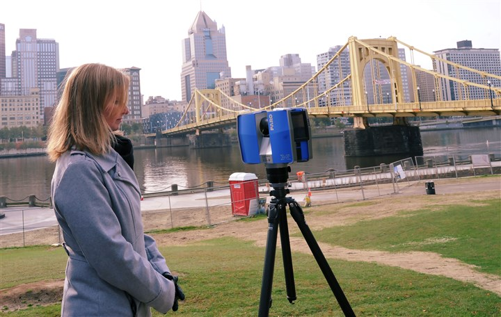 20161026ng-3D Michelle Edwards, applications engineering manager for Faro Technologies, uses a laser to collect data about the Roberto Clemente Bridge.